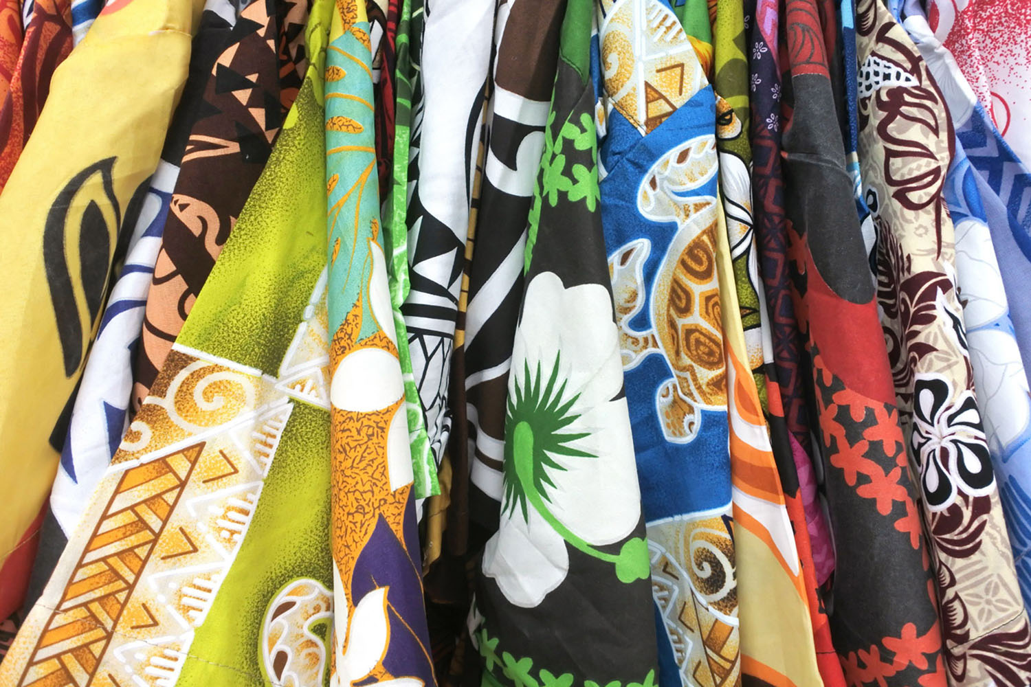 Colorful shirts with island patterns for sale in a shopping distract