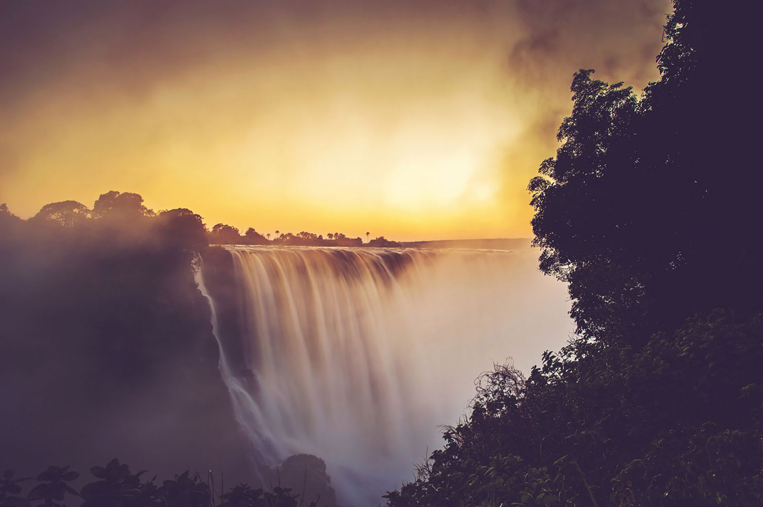 The Victoria Falls in flood at sunrise