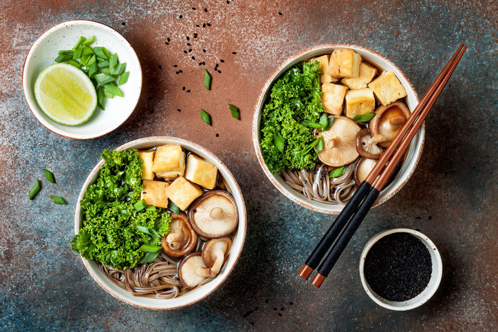 Miso and soba noodles soup with kale, shiitake mushrooms, roasted tofu