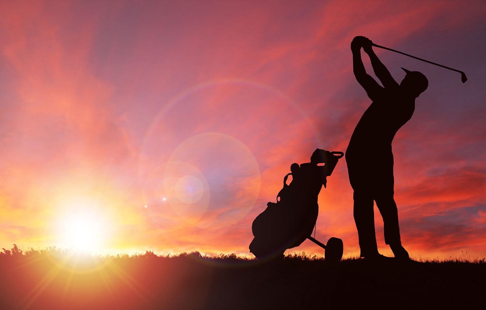 A golfer at sunset