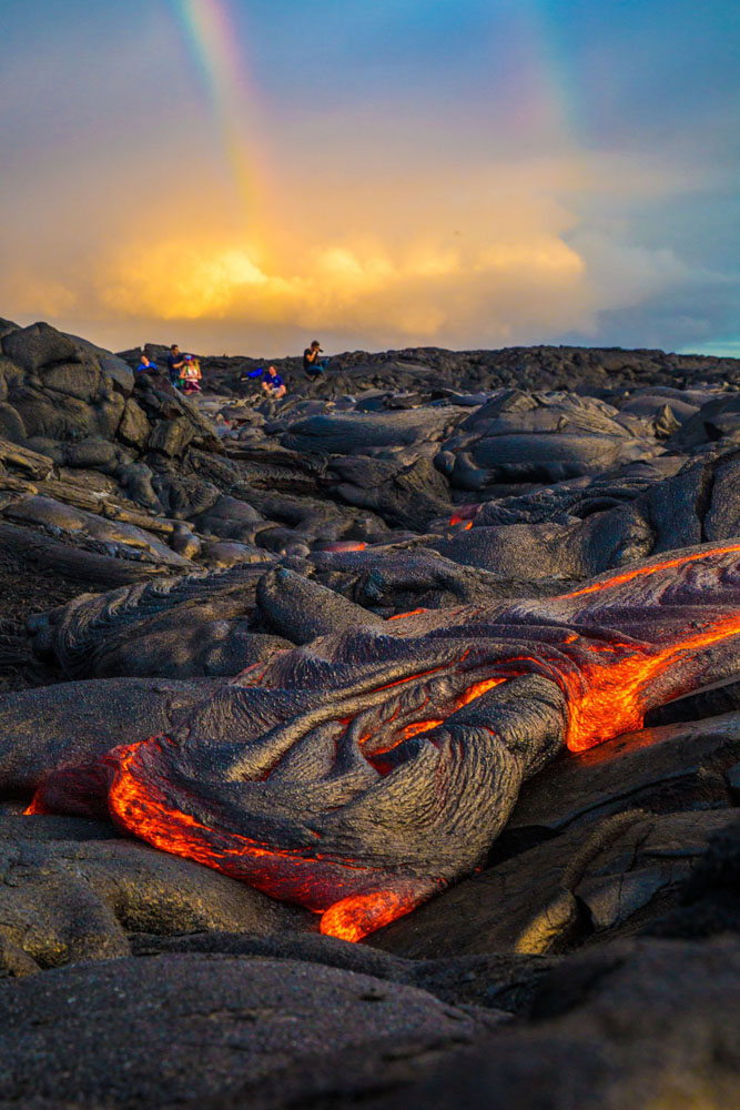 Travelers explore the rock formations in Hawaii Volcanoes National Park