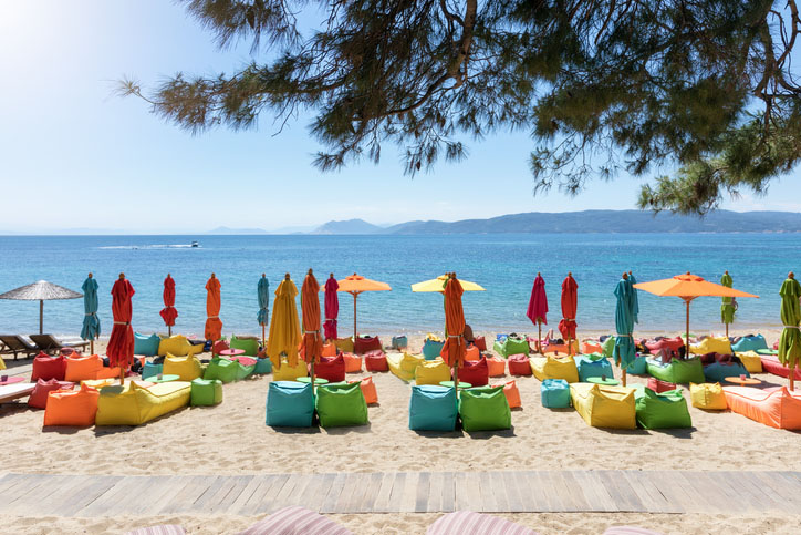 Umbrellas and lounge chairs on the beach in Skiathos, Greece