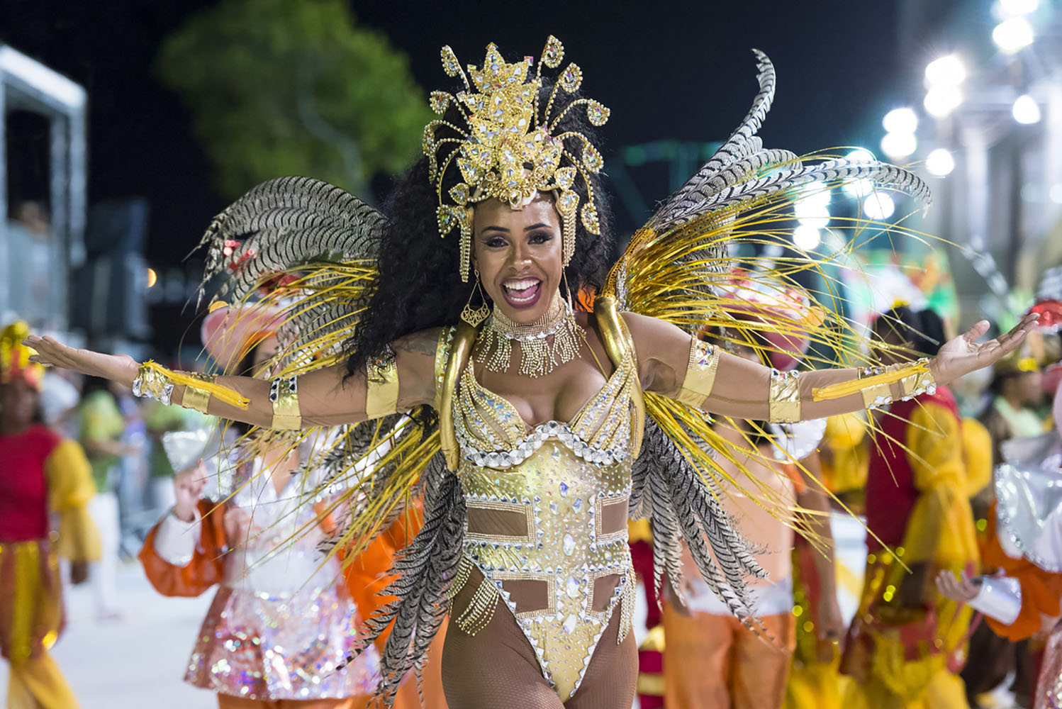 A woman dances in costume at Carnaval in Rio