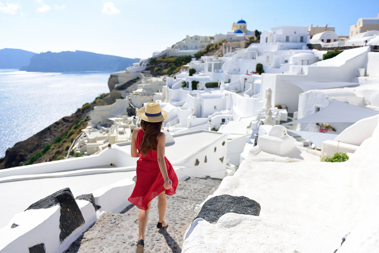 Walking is a great way to explore a travel destination, like beautiful Santorini.