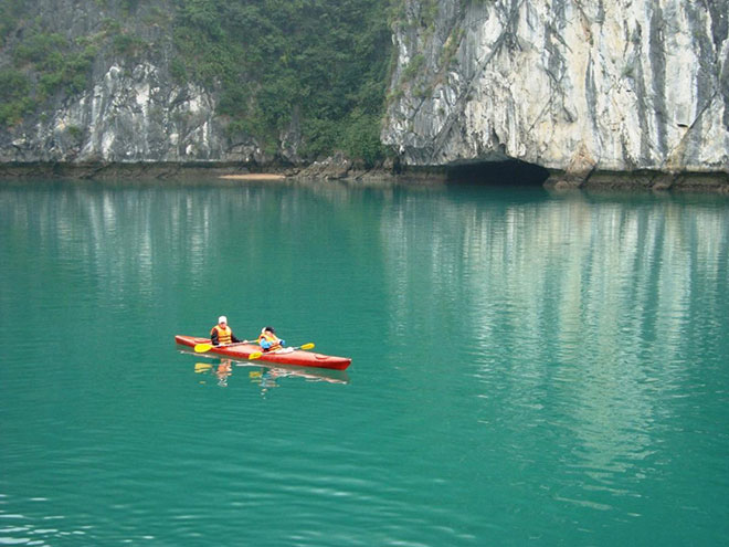 Kayak in front of cave