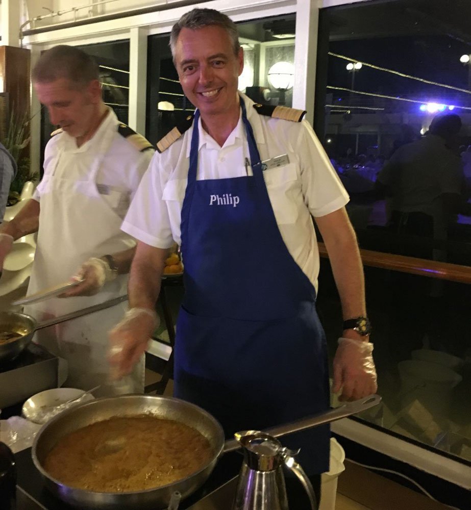 The cruise ship crew making Crepes Suzette during Azamara's White Night party.