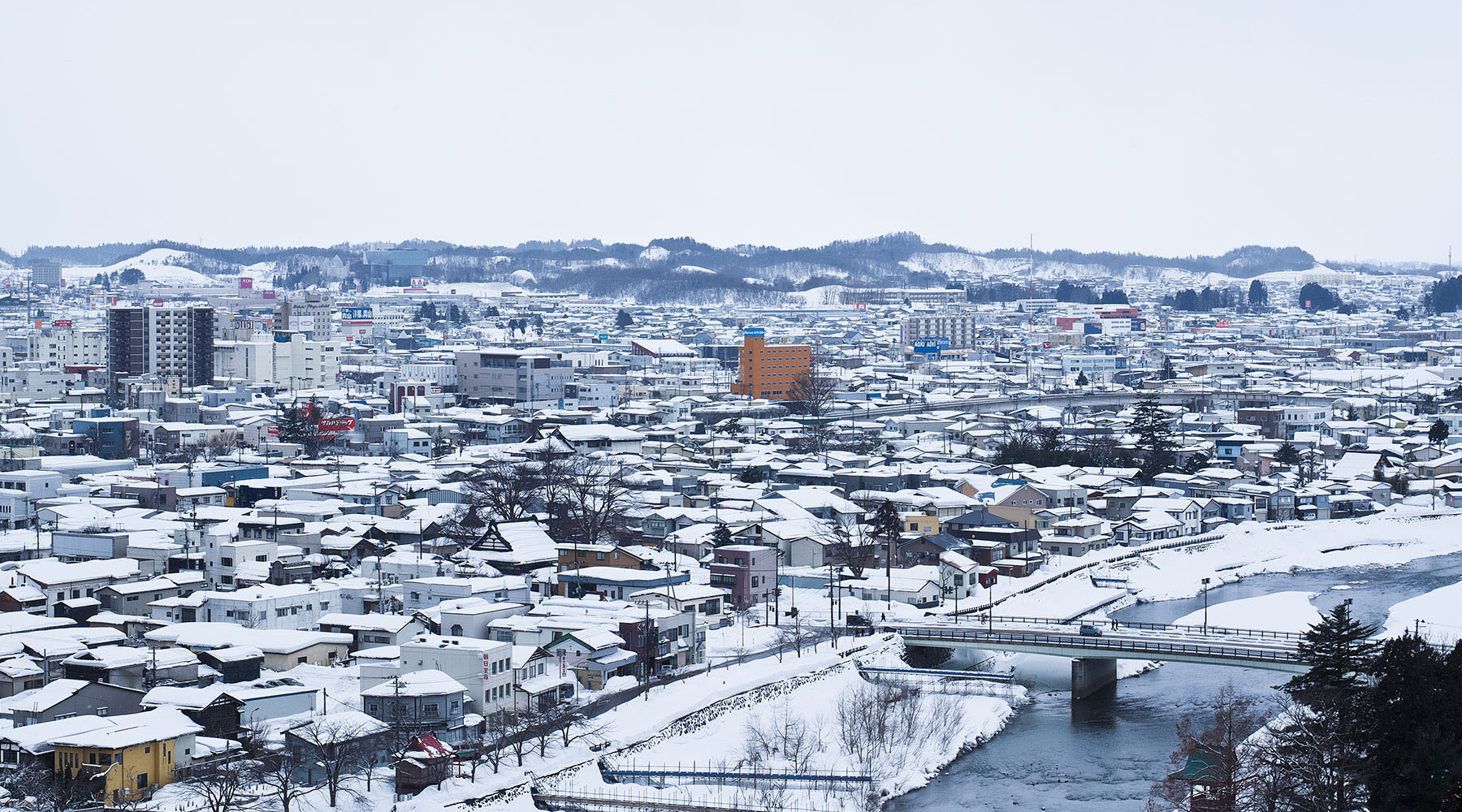 Snow-topped buildings of Akita Japan during winter