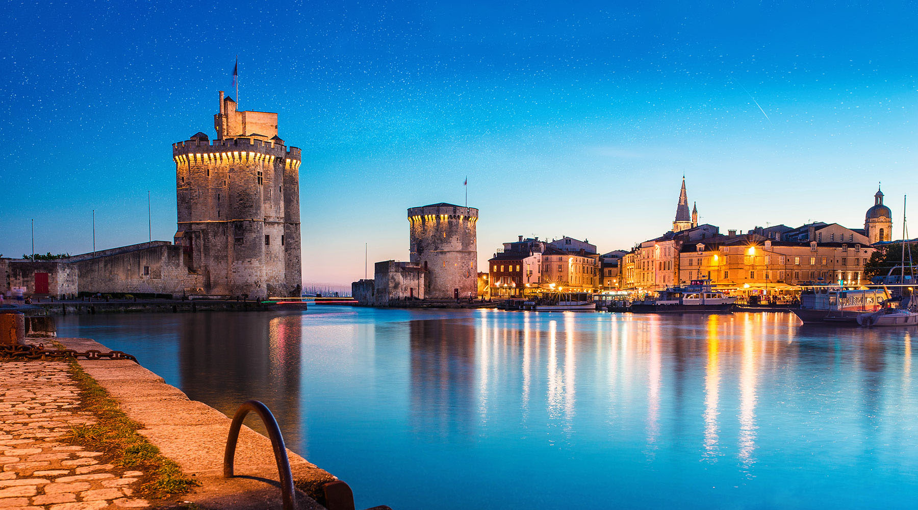 La Rochelle is a small port that is big on charm and enchants visitors with its sunny ways.