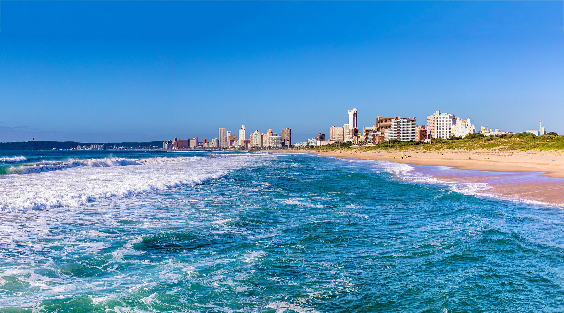 blue waves rolling onto a beach in durban south africa