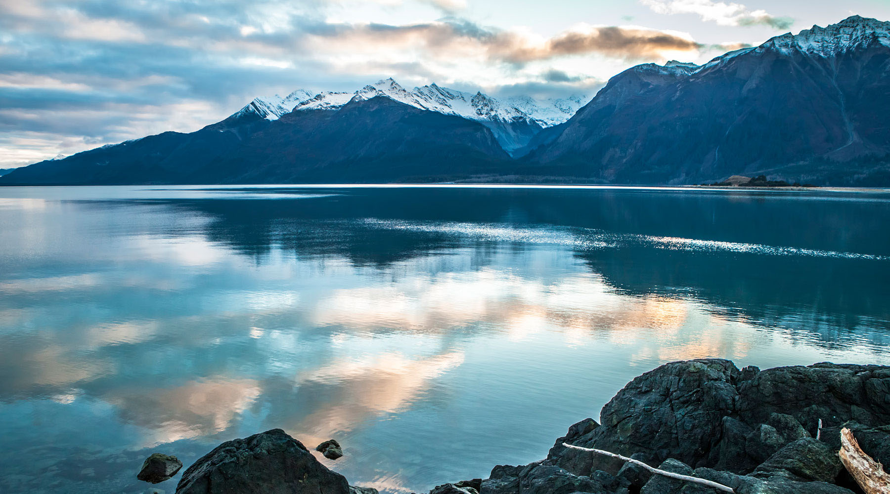 Snowy blue mountains and icy waters of Haines Alaska