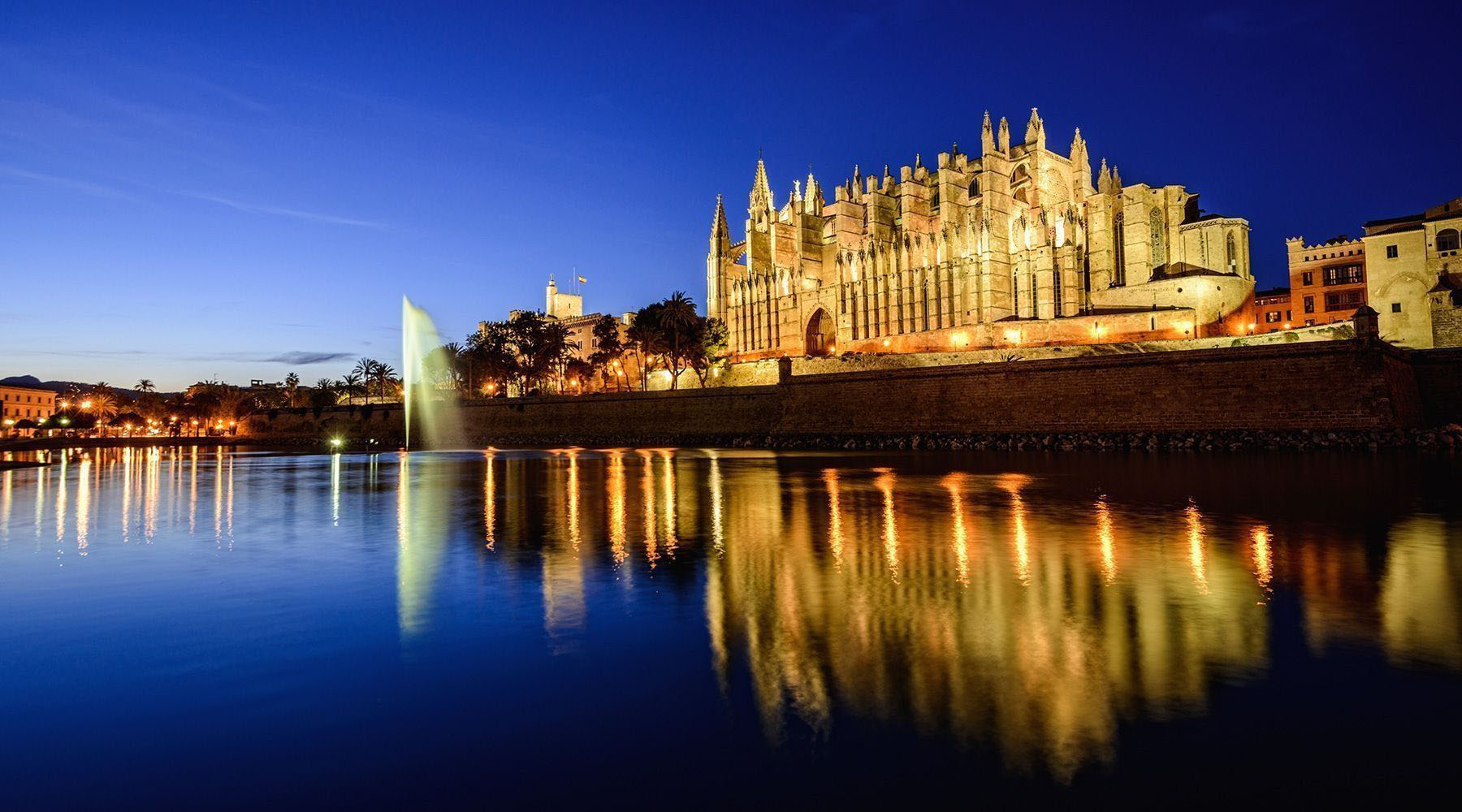brown museum beside body of water during sunset in palma de mallorca spain