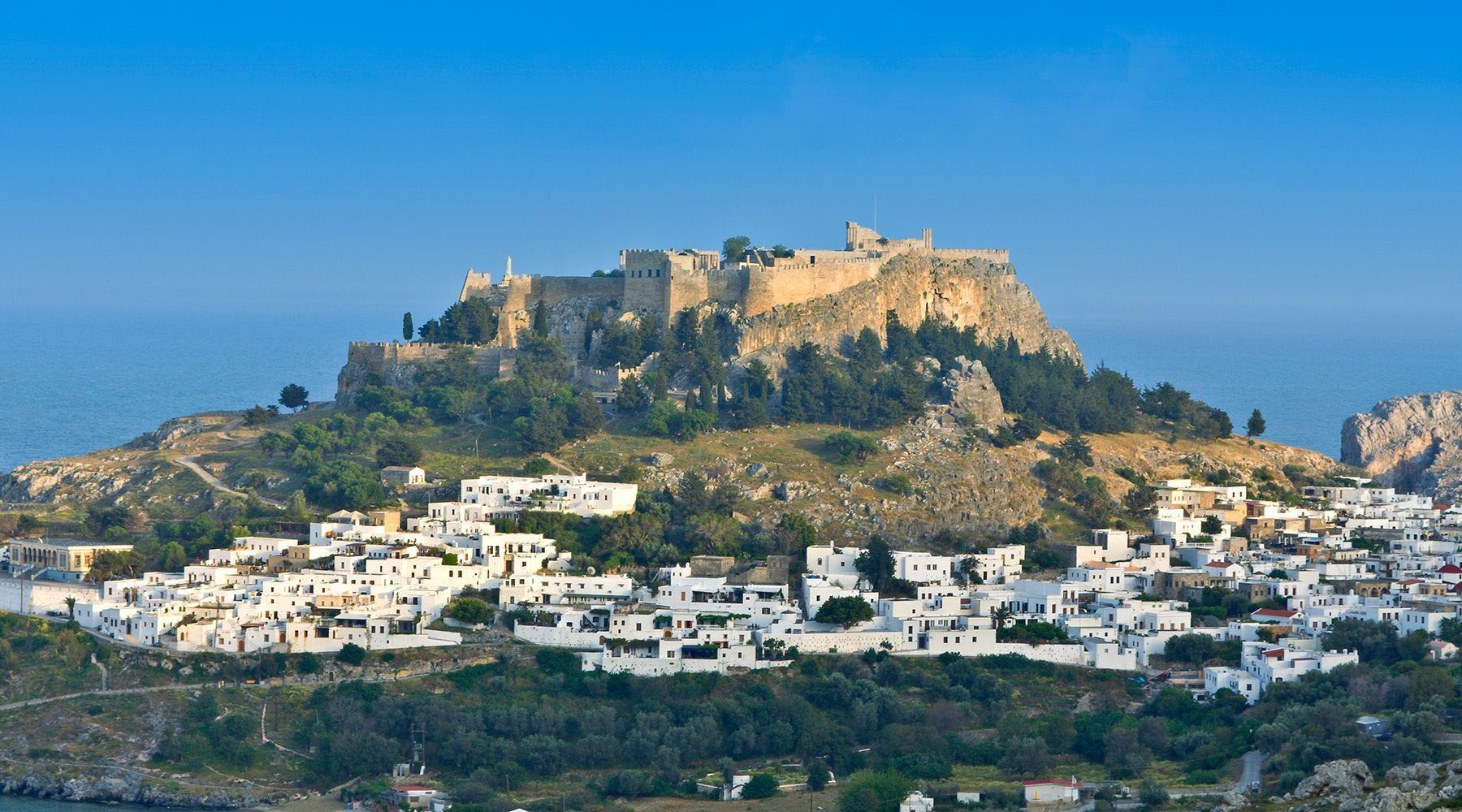 city scale near brown mountain hill at daytime in patmos greece