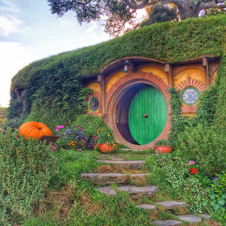 A hobbit house with a green door from the hobbiton movie set