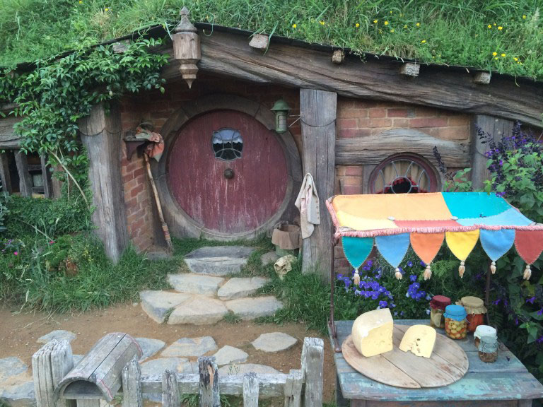 A hobbit house with a purple door from the hobbiton movie set