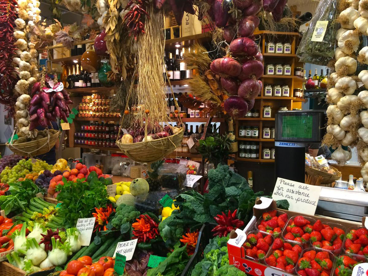 Baskets of fruits and vegetables in the San Lorenzo market in Florence, Italy