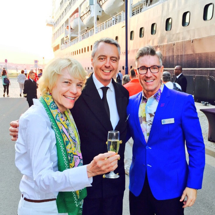 A champagne toast next to an Azamara cruise ship