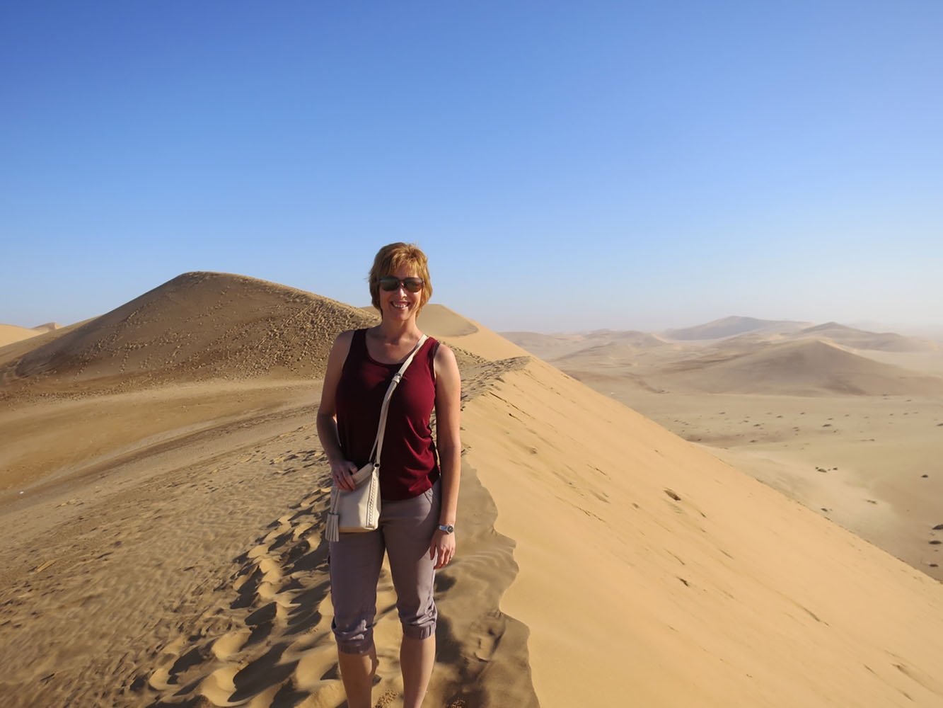 Liesl standing in the desert in Namibia.