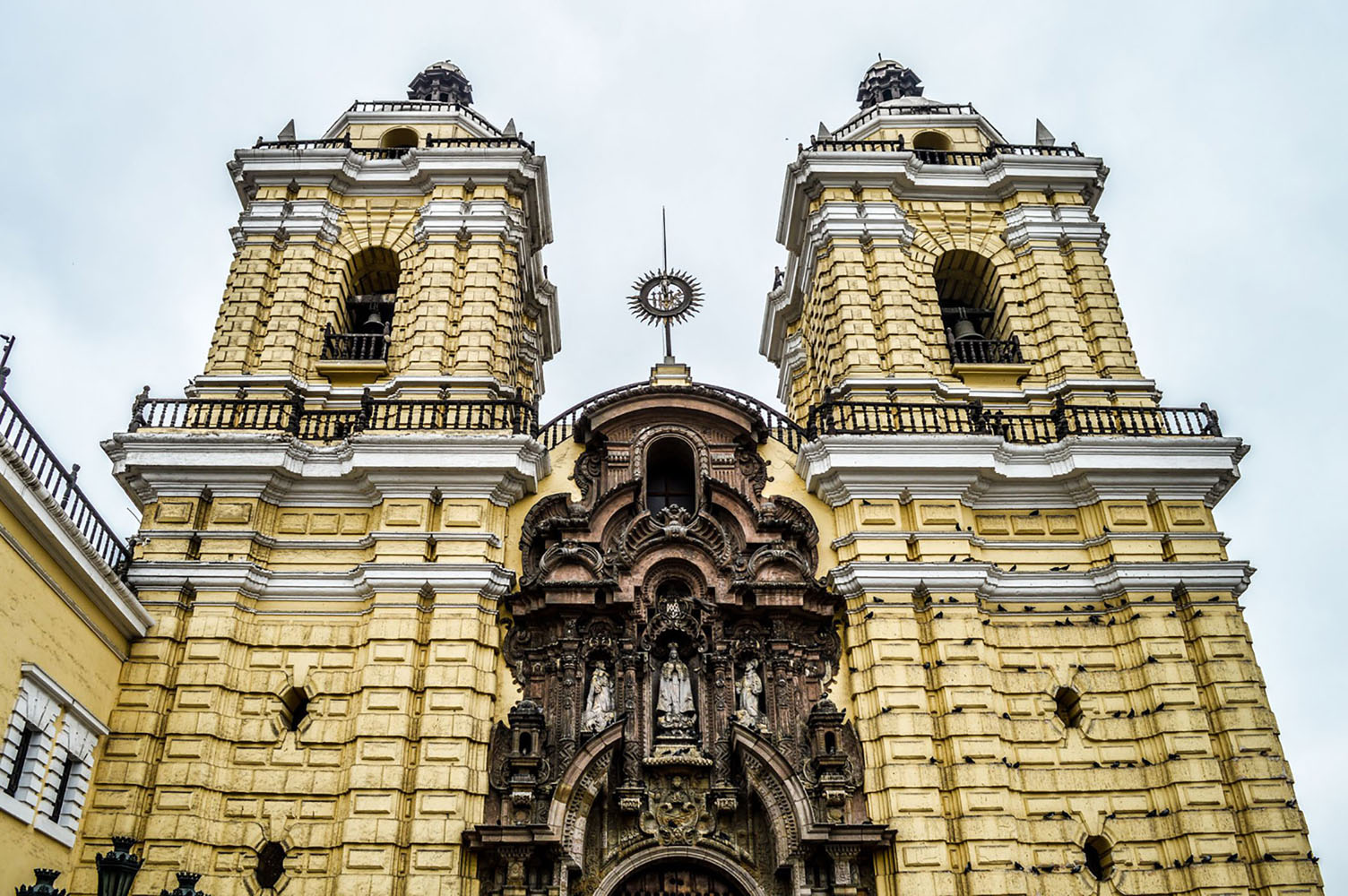 The yellow exterior of the Monasterio de San Francisco in Lima