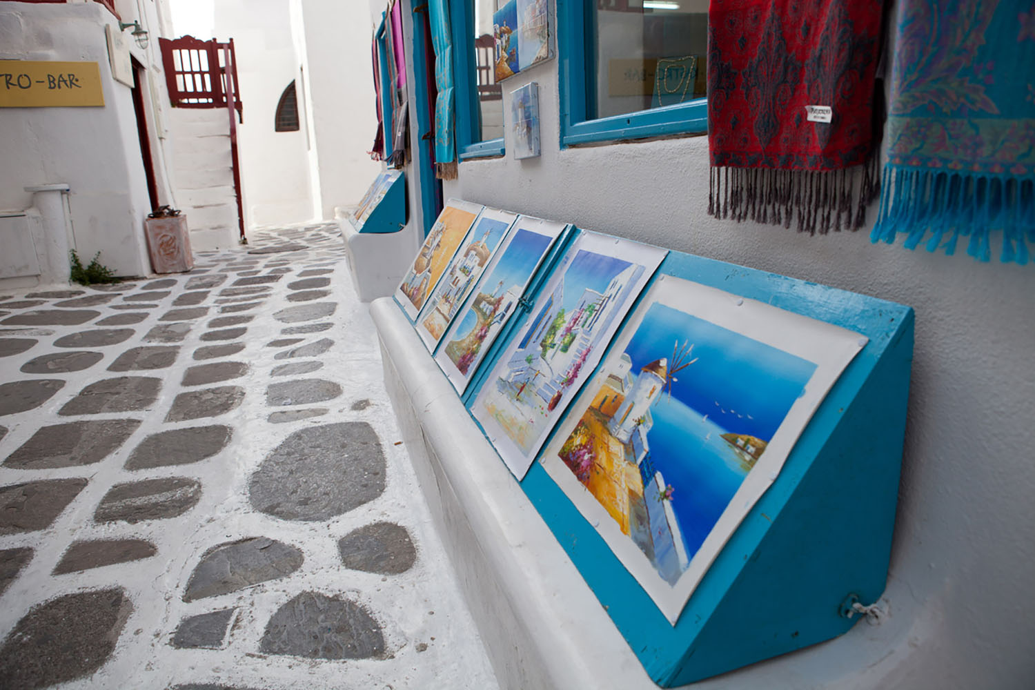 One of the best things to do in Mykonos is stroll the cobblestoned streets and shop for souvenirs.
