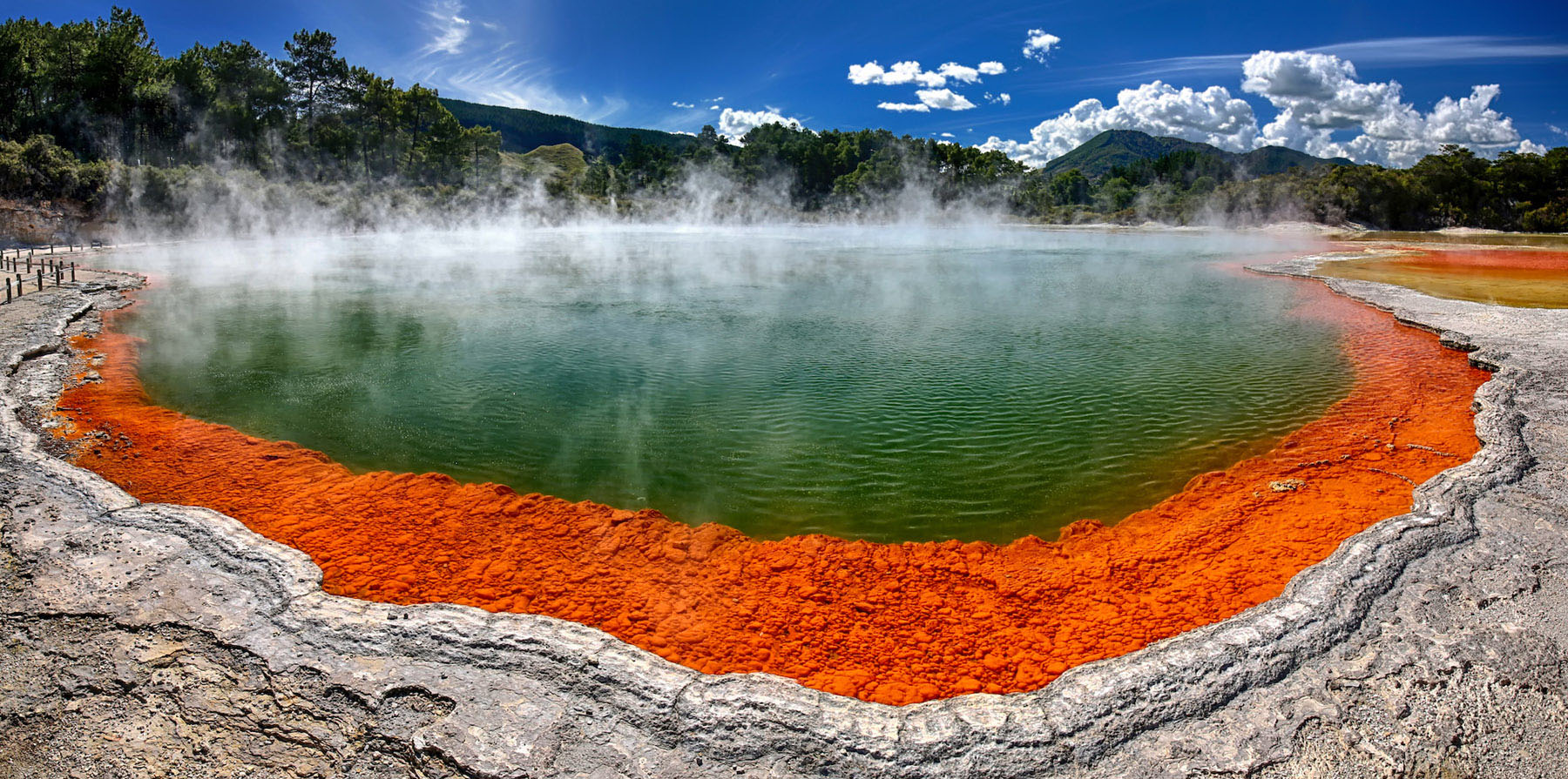 Visit the famous Champagne Pool in Rotorua, New Zealand.
