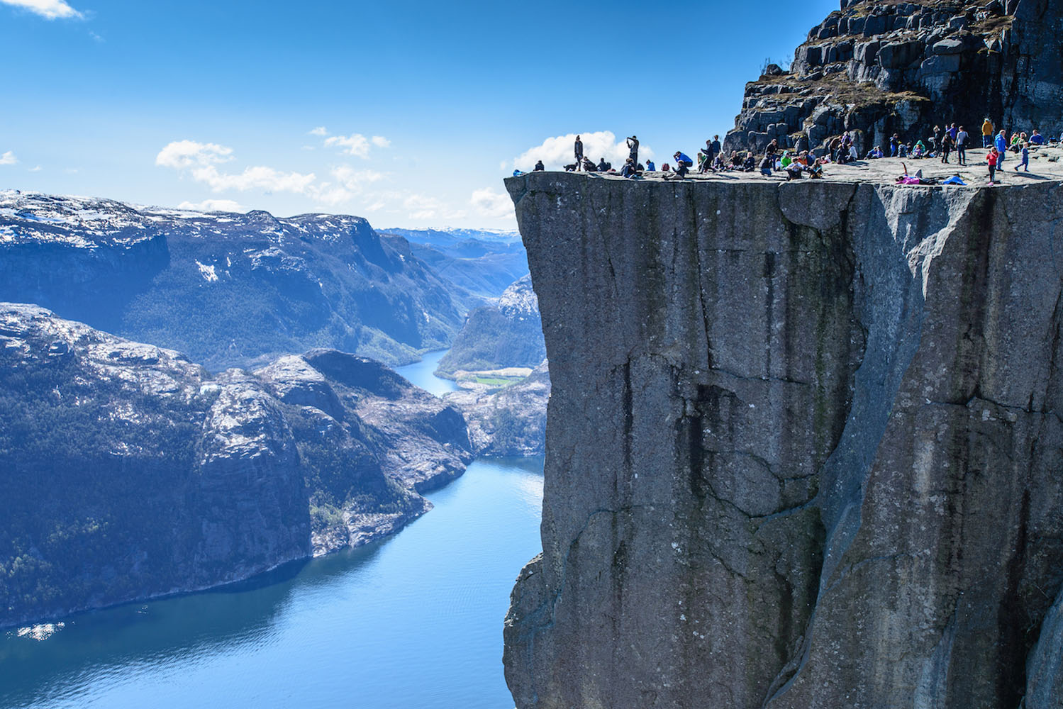 People hiking on the cliffs of Norway