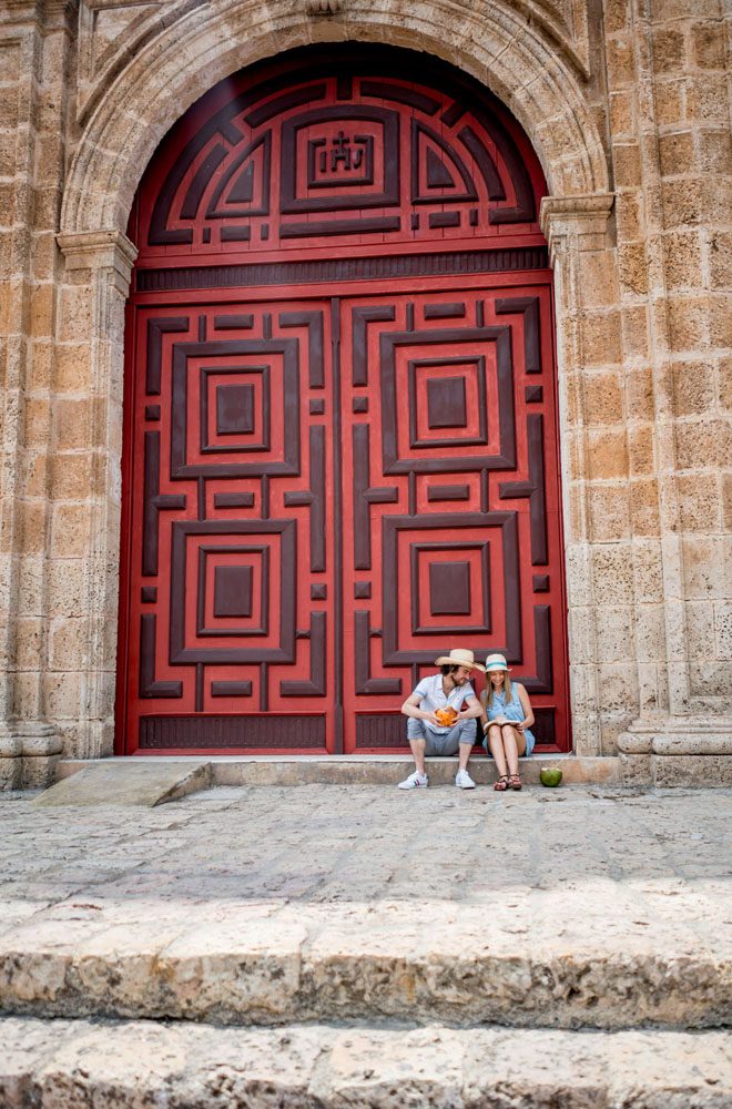 Ornate red entryway to the Iglesia de San Pedro Claver in Cartagena