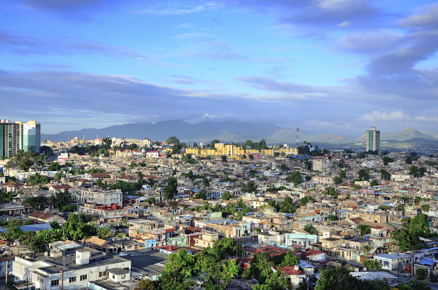 Santiago de Cuba is a cultural hub, nestled between the breathtaking Sierra Maestra mountain range and the dazzling Caribbean Sea.