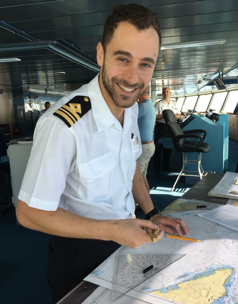 First Officer, Simone Patalano, plotting a cruise route on paper charts
