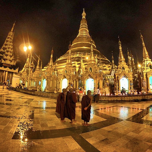 Yangon, Myanmar's Shwedagon Pagoda at night.