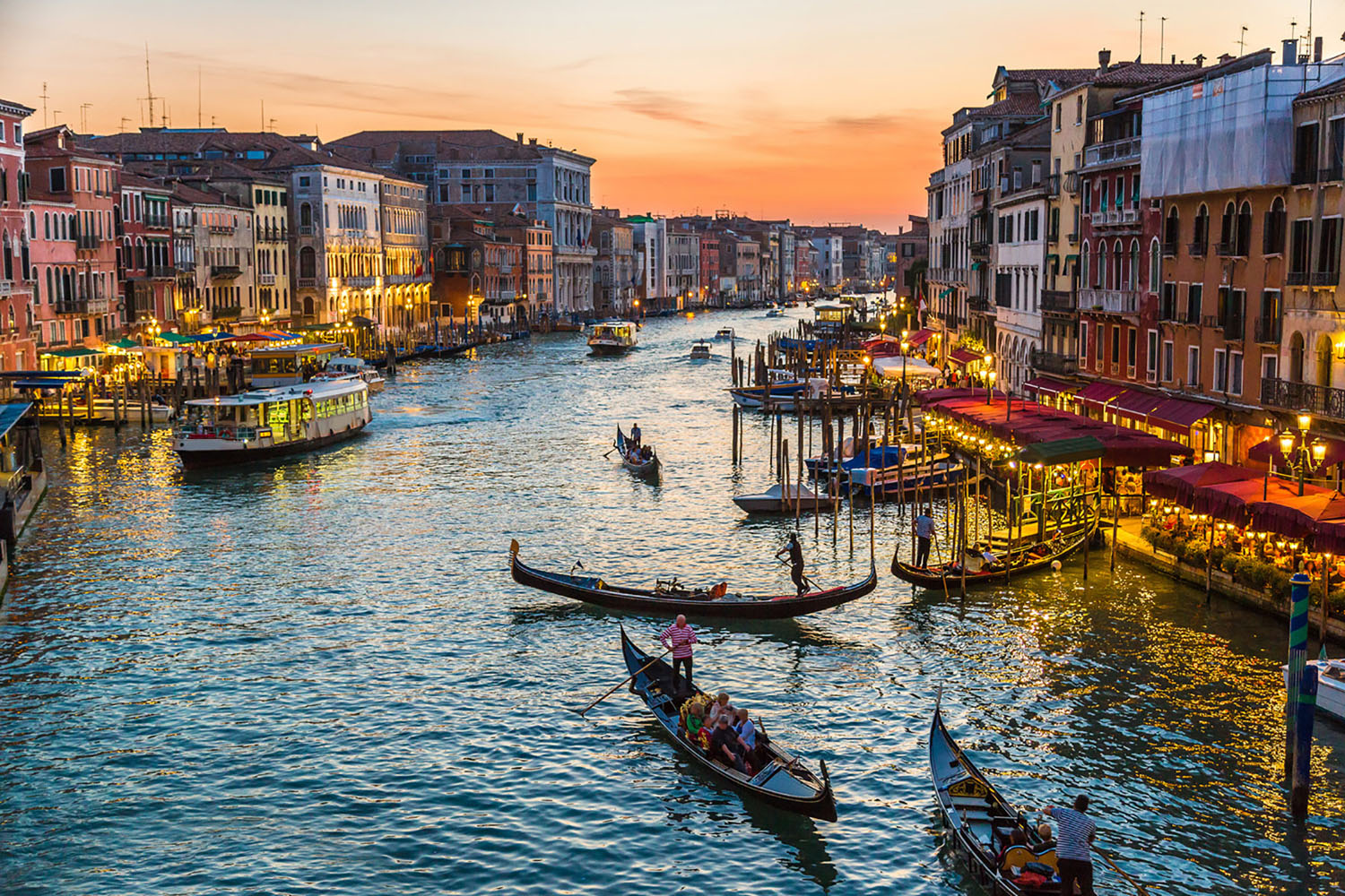 Gondolas in a Venice canal at sunset.