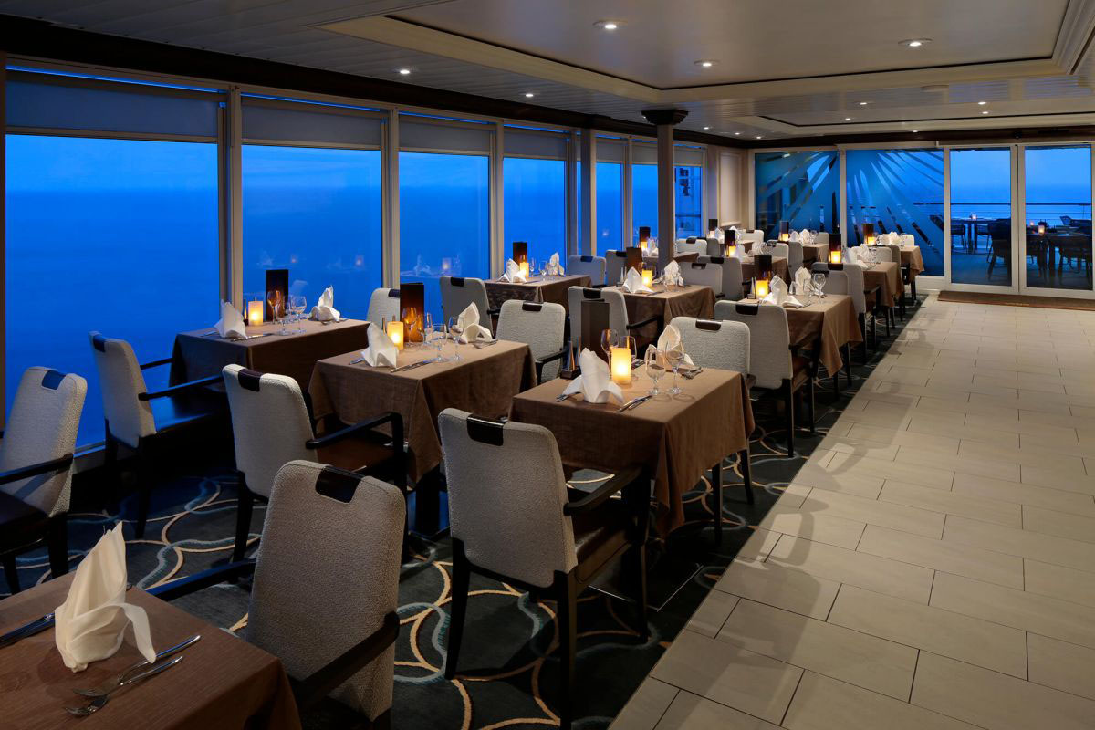 Tables set for dinner at the Windows Cafe on Deck 9